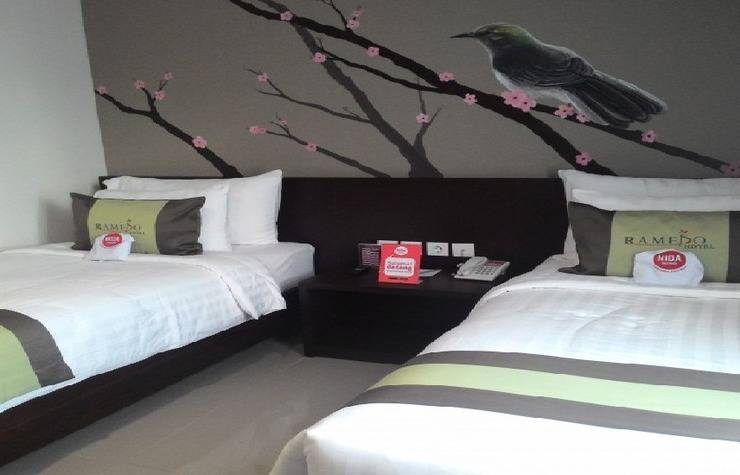 NIDA Rooms Landak Baru 112 Makassar - Kamar tidur