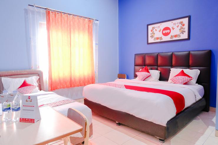 OYO 778 Guest House Amalia Malang Malang - Bedroom