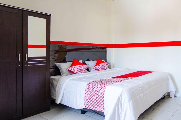 OYO 776 Bless House Manado - Bedroom