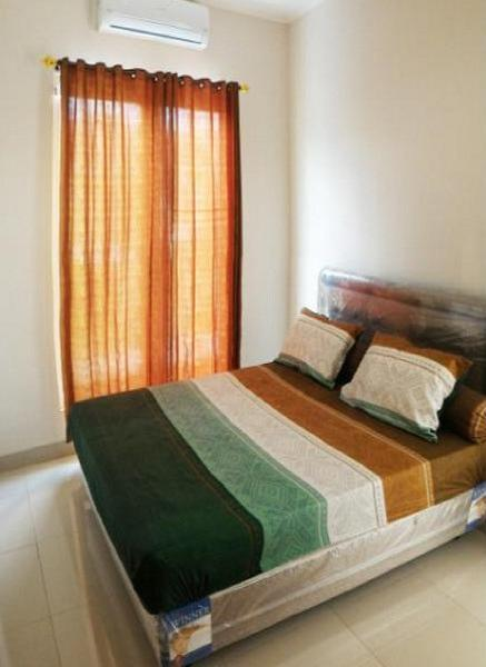 D'Home Guesthouse Samarinda - Guest room