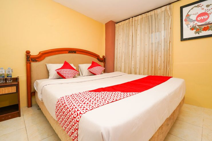OYO 710 Naomi Heritage Surabaya - Bedroom