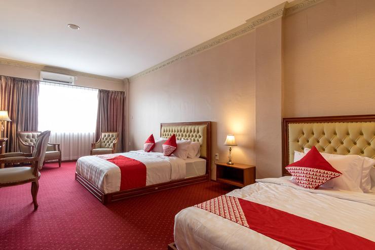 OYO 293 Mutiara Hijau Suites Syariah Medan - Bedroom
