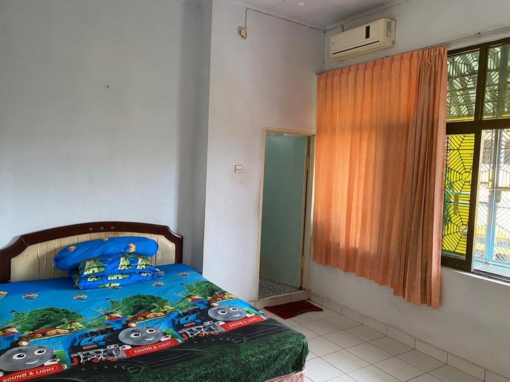 Bulusaraung Homestay Makassar Makassar - Bedroom