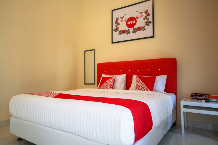 OYO 2202 Delima Guest House Syariah Padang - Bedroom