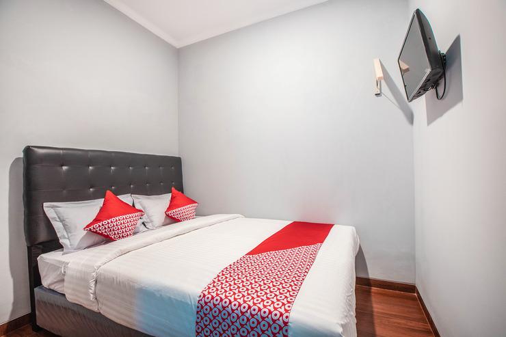 OYO 842 Arafuru Residence Jakarta - Bedroom