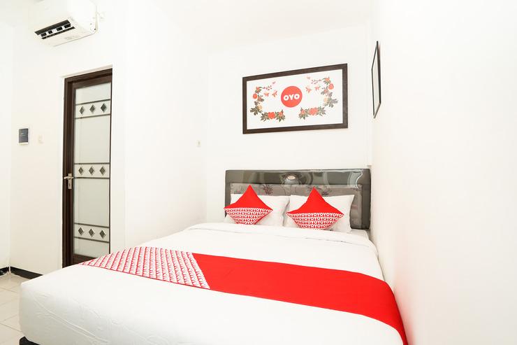 OYO 473 Darmo permai Guesthouse Surabaya - Bedroom
