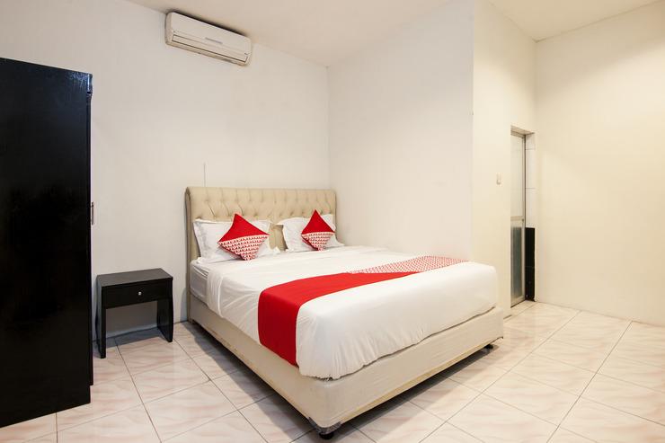 OYO 529 Hotel Paninda Medan - Bedroom