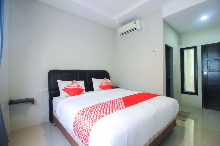 OYO 1227 Variz Homestay Pekanbaru - Bedroom