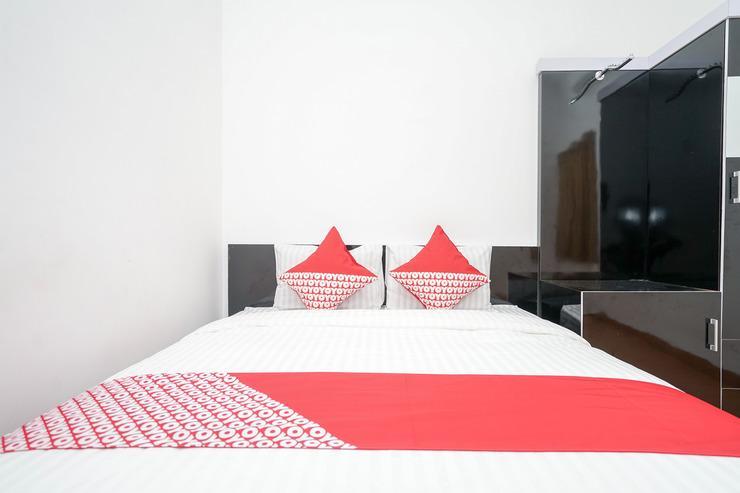 OYO 445 Lavender Homestay Syariah Palembang - Bed room