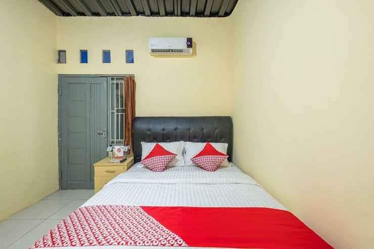 OYO 1120 Hotel Grand Liquid Karawang - Bedroom