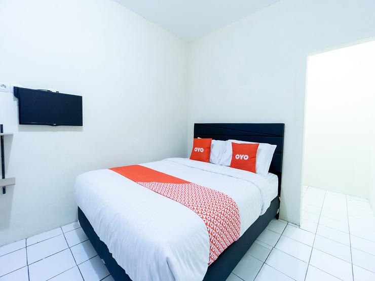 OYO 591 Mn Residence Near RS Mediros Jakarta - Bedroom