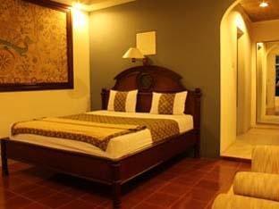 Pecatu Guest House Bali - Kamar Deluxe dengan Pemandangan Taman
