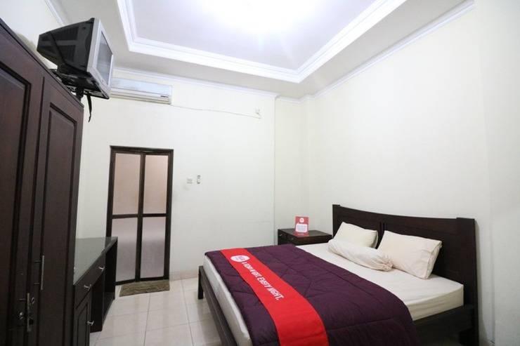 NIDA Rooms Ring Road Utara 1E Jogja - Kamar tidur