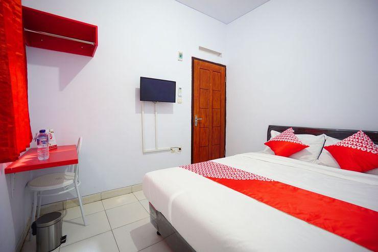 OYO 1064 Manado Airport Homestay Manado - Bedroom