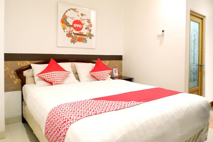 OYO 577 Ndalem Pundhi Guest House Yogyakarta - Bedroom