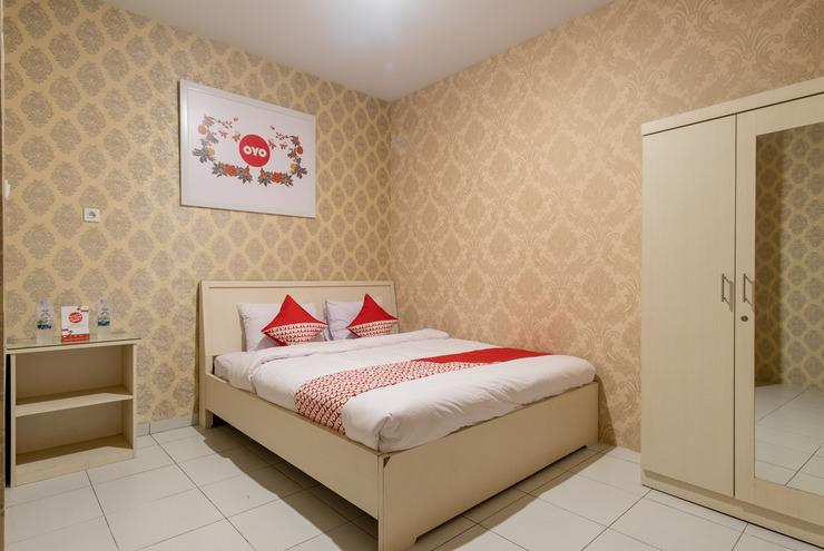 OYO 359 Executive Inn Medan - Delux double bedroom