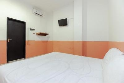 On Inn Guest House 1 Manado - Bedroom