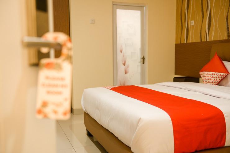 OYO 149 JKostel Syariah Palembang - Bedroom
