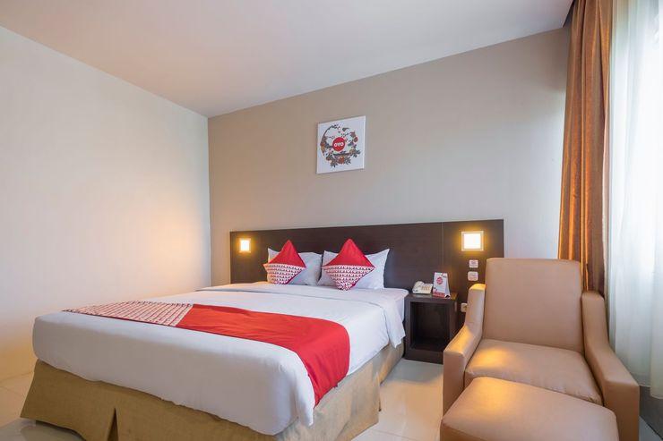 Capital O 1279 Hotel Grand Celino Makassar Makassar - Bedroom