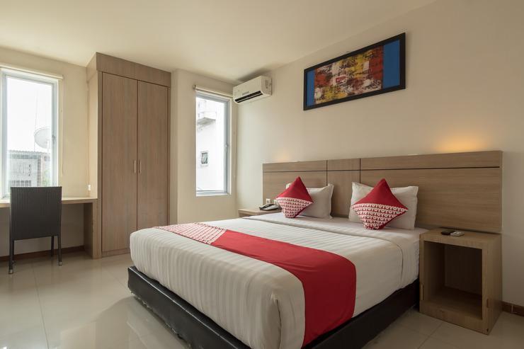 OYO 319 Putra Mulia Hotel Medan - Bedroom