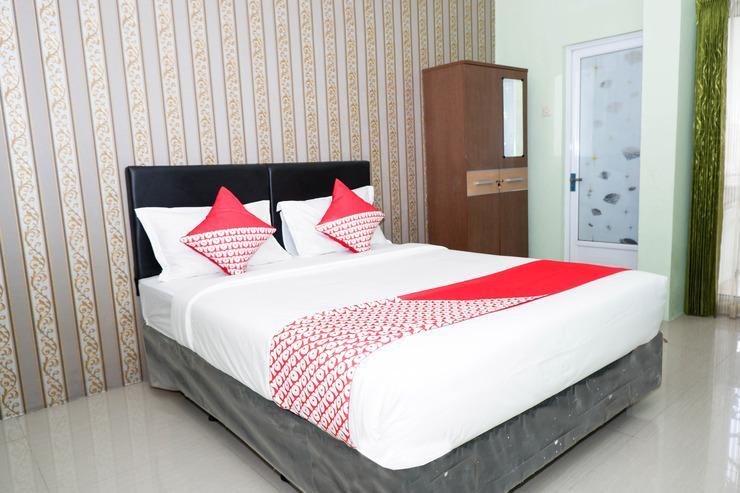OYO 338 Guest House Omah Manahan Syariah Solo - Bedroom