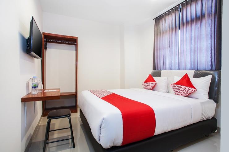 OYO 491 Uno Hotel Surabaya - Bedroom
