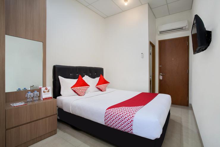 OYO 106 Sarkawi Residence Jakarta - Bedroom