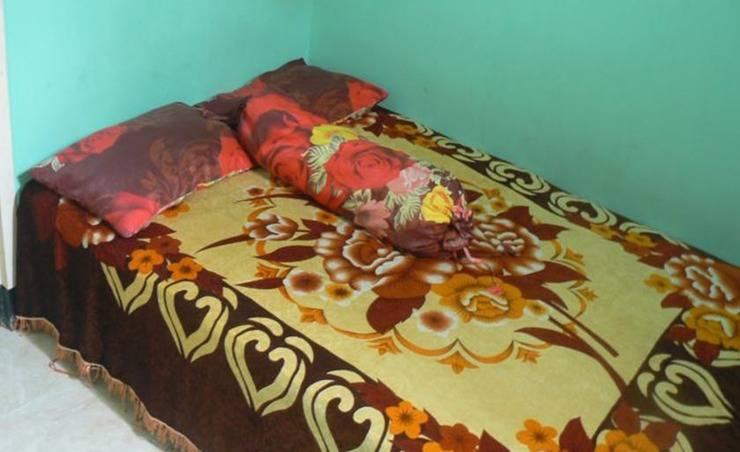 Kawah Ijen Inn Banyuwangi - Kamar tamu