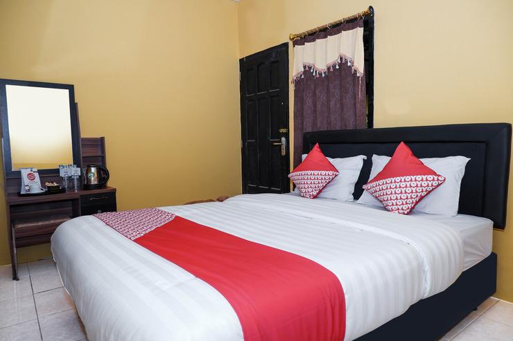 OYO 598 Udan Mas Guesthouse& Gallery Magelang - Bedroom