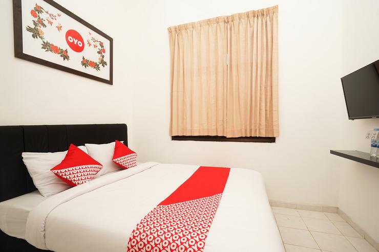 OYO 485 Marcello Residence Surabaya - Bedroom
