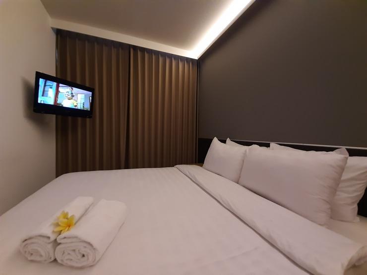 Hotel Pantes Simpang Lima Semarang - Tempat tidur yang nyaman dengan linen yang bersih