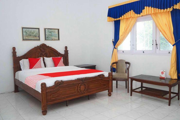 OYO 1148 Pelangi Hotel New Teluk Uber Bangka - Bedroom