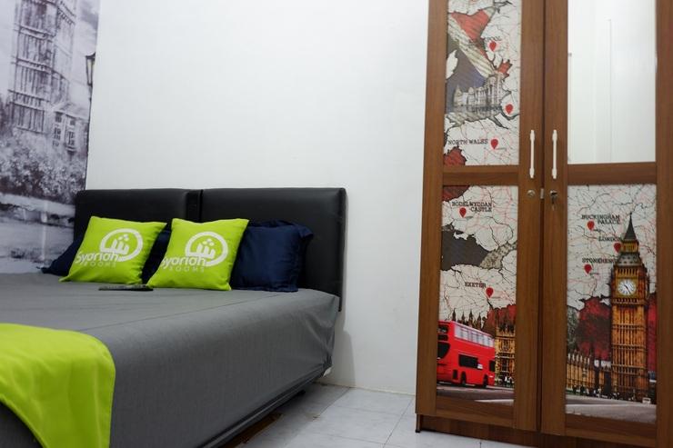Maharaja Homestay Syariah Malang - bedroom