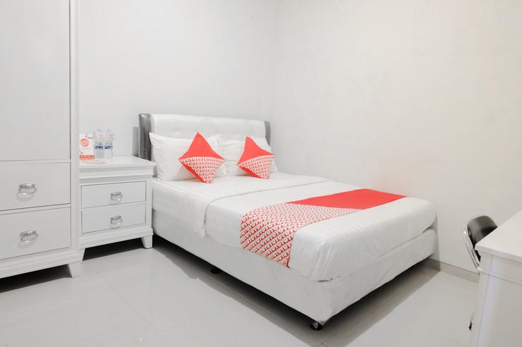 OYO 407 Bandahara 21 Syariah Malang - Bed Room
