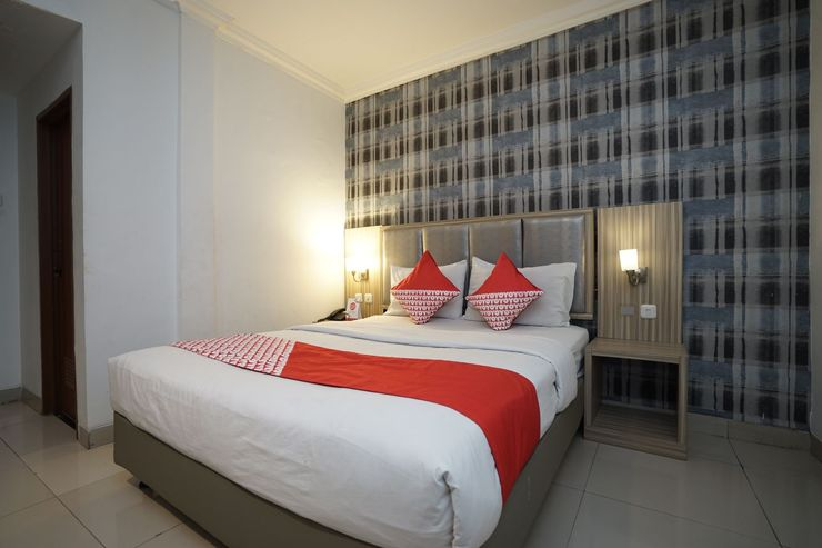 OYO 1282 Feodora Airport Hotel Palembang - Bedroom