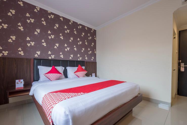 OYO 308 Grand Pacifik Hotel Makassar - Bedroom