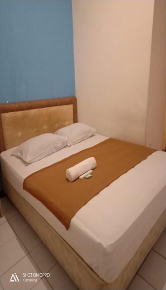 Relasi Hotel  Palembang - room