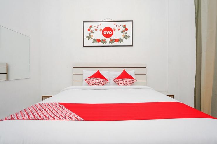 OYO 661 Galaxy Homestay Surabaya - Bedroom