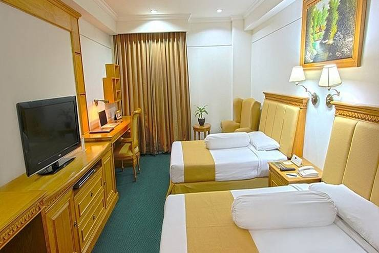 Harmoni Suites Hotel Batam - Kamar Tamu