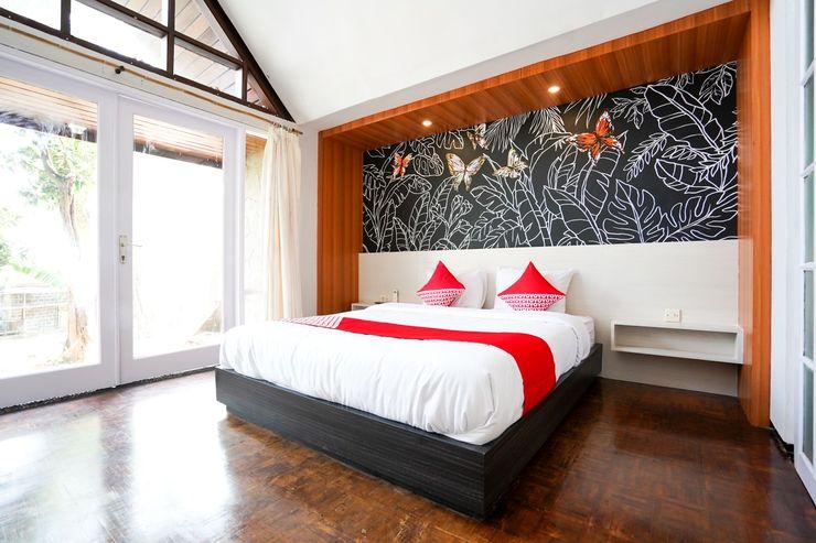 OYO 430 Grand Mulia Sakinah Boutique Hotel Pasuruan - Bedroom