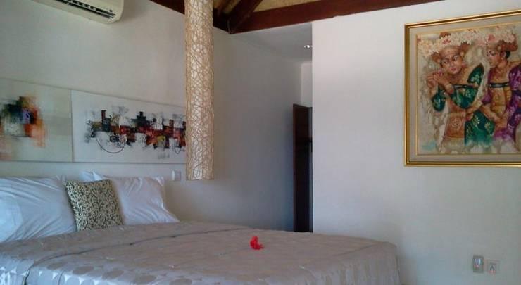 Bali Santi Bungalows Bali - Bed kamar standar dengan pemandangan laut