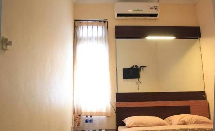 Khresna Guest House Jogja - Kamar tamu