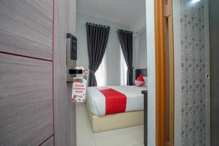OYO 558 Maximus Prime Palembang - Bedroom