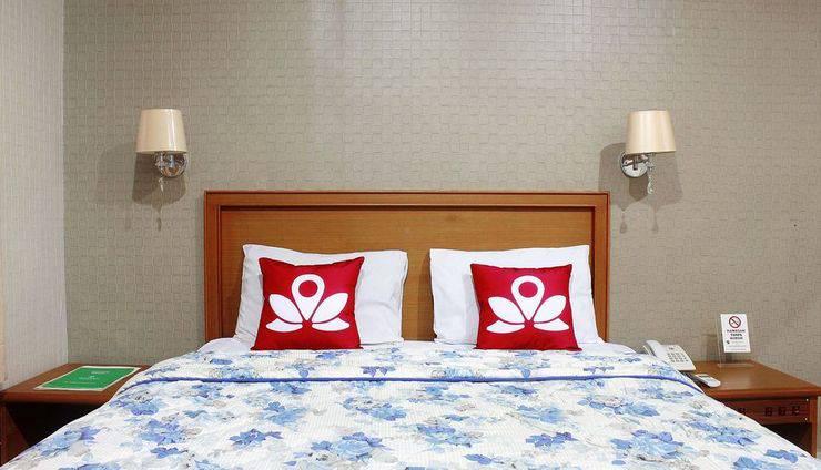 ZEN Rooms Sawojajar Bogor - tempat tidur