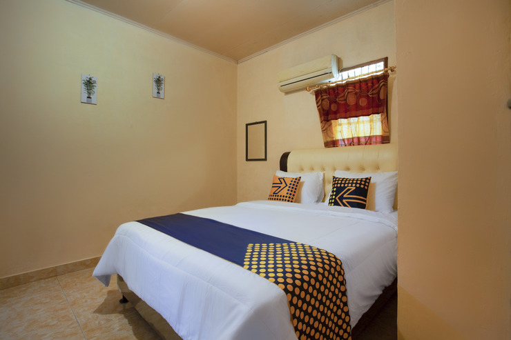 SPOT ON 2946 Harland Guesthouse Padang - Guestroom