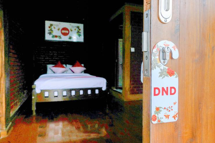 OYO 774 Villa 007 Sengkaling Malang - Bedroom