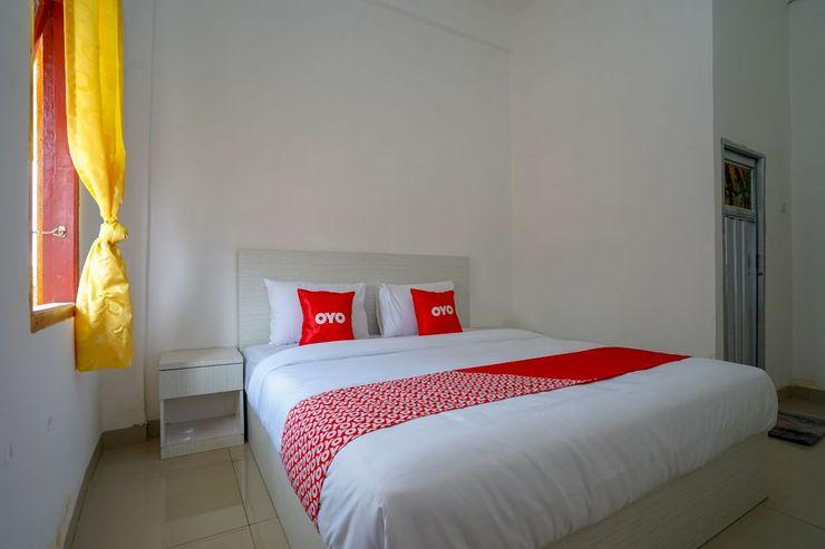 OYO 1146 Miracle Homestay Syariah Palembang - Bedroom