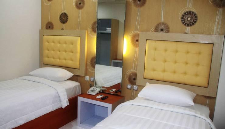 Niraz Guest House Banjarmasin - dua tempat tidur
