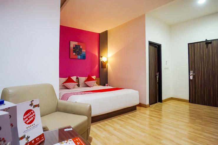 OYO 770 De Nearby Hotel Manado - Bedroom