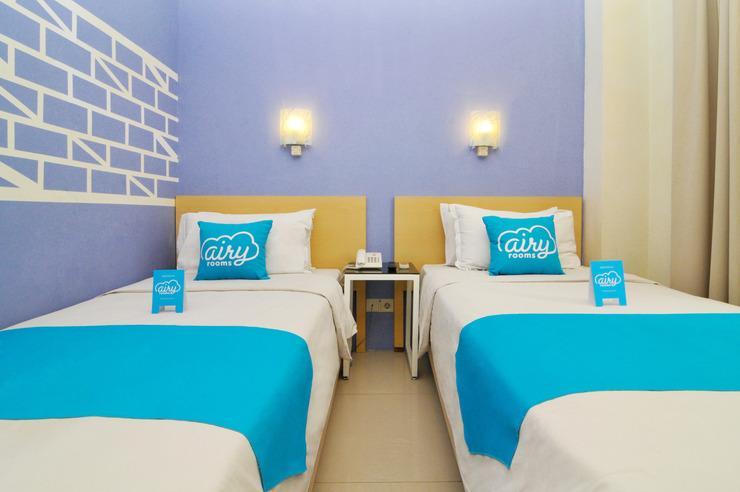 Airy Wenang Sutomo 4 Manado - Bedroom
